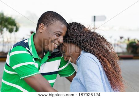 happy young couple embracing , communicates perfectly