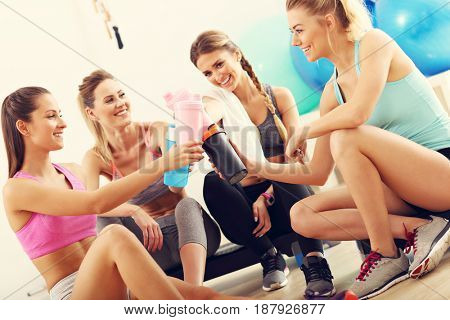 Group of happy women resting after aerobics