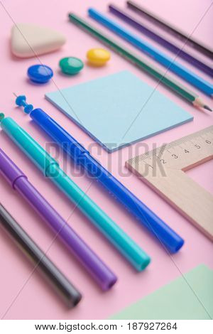 Image of a lot of office supplies on the pink background table