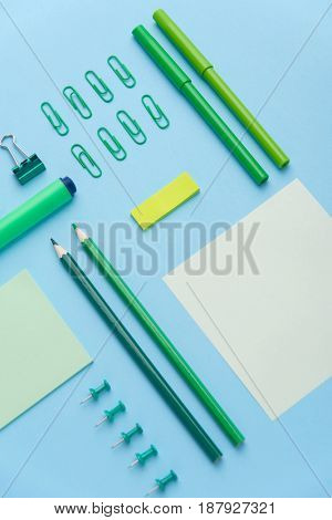 Image of office supplies on the blue background table