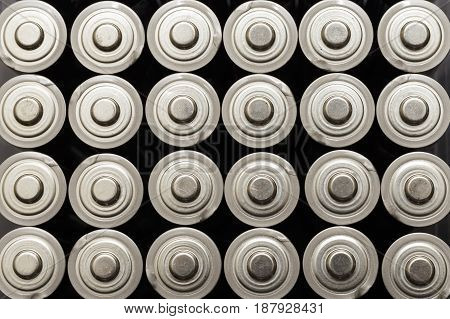 many rows of AA batteries lined up perfectly