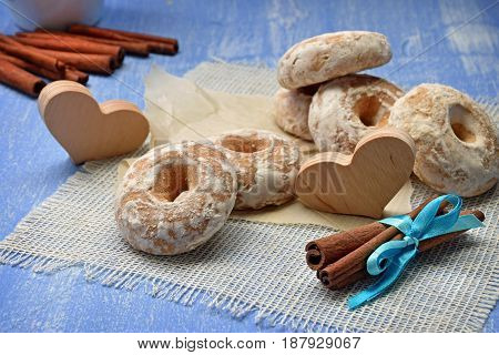 Cookies with spices in the glaze. The concept: cooked with love. Cinnamon sticks and baking close-up. Festive mood. Rustic style.