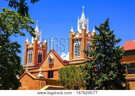 Albuquerque, NM, USA - 06/17/2015: San Felipe de Neri Parish Church is a historic Catholic church located on the north side of Old Town Plaza in Albuquerque New Mexico. Built in 1793 it is one of the oldest surviving buildings in the city