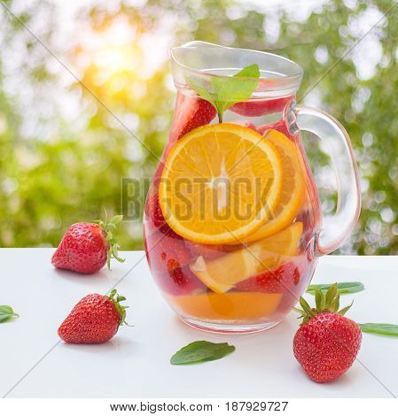 Aromatized Water With Fresh Strawberries And Mint In A Glass Jug .