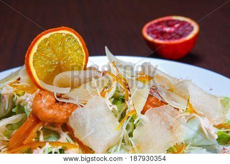 Shrimps and orange salad. Delightful healthy consumption.