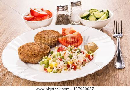 Fried Cutlets With Vegetable Mix, Slices Of Tomatoes And Cucumbers