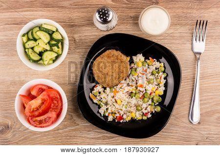 Fried Cutlet With Vegetable Mix In Plate, Tomatoes. Cucumbers, Mayonnaise