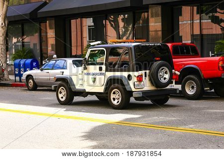 Beverly Hills, CA, USA - 07/01/2015: A Beverly Hills Parking Enforcement jeep patrols the streets of this suburb of Los Angeles in California