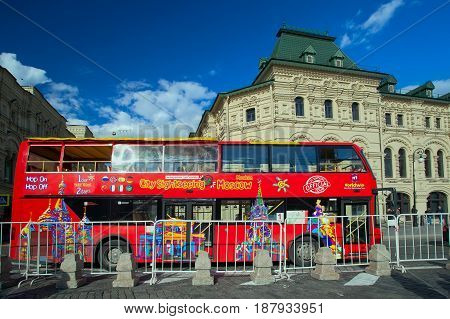 Moscow Russia - May 13 2017: Tour double-Decker bus City Sihgtseeng near department store on Red square in Moscow
