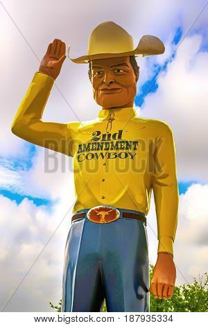 Amarillo, TX, USA - 06/16/2015: 2nd Amendment Cowboy statue in Amarillo Texas. (the right of the people to keep and bear Arms shall not be infringed)