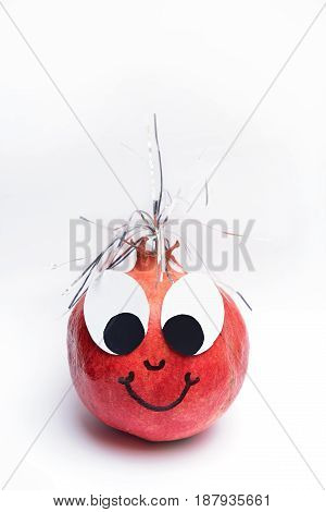 red pomegranate with smiling funny face silver glitter and big eyes