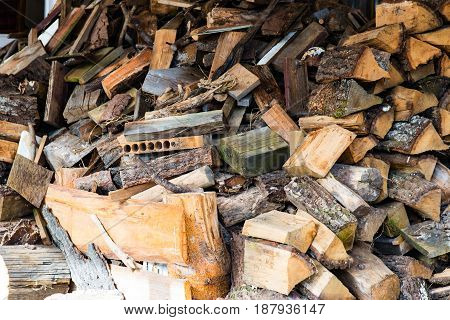 Much Plenty of firewood for the fireplace in a pile