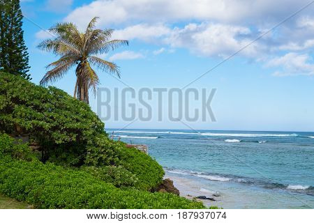 Tropical paradise at Bathtub Beach in Laie Oahu Hawaii with the Pacific Ocean and the sandy beach.