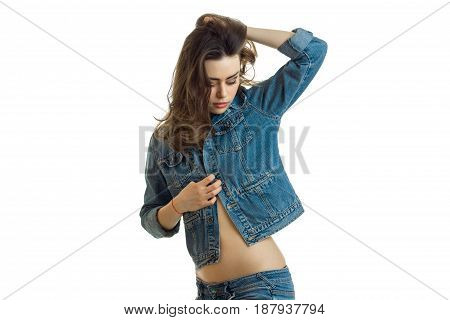 a charming young girl with beautiful dark hair cocked her head in jeans jacket isolated on white background