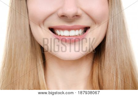 Smiling young woman on white background, close up