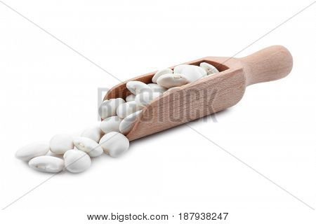 Wooden scoop with butter beans on white background