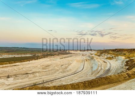 Сhalk and clay quarry in the early morning. Belgorod chalk quarry landscape. Deposits in the Belgorod region- the largest in Russia. Hilly horizon.