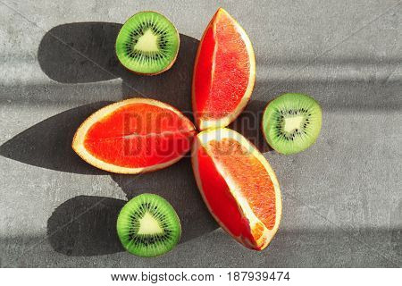 Beautiful composition with fresh fruits on gray background