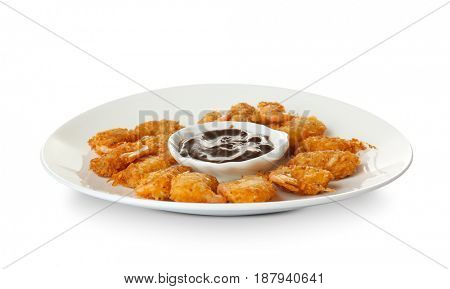 Plate with delicious coconut shrimps on white background