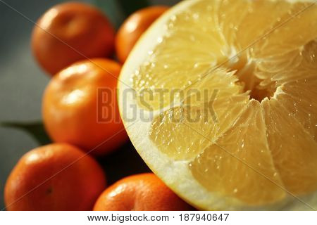 Half of pomelo and tangerines, closeup