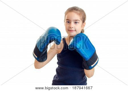 amazing little girl keeps before itself hands in large adult boxing gloves close-up isolated on a white background