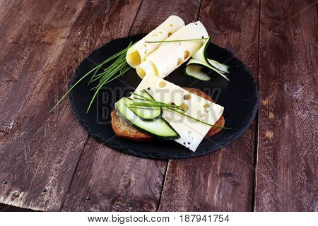 Bread With Slices Of Cheese For Lunch Table. Sharing Antipasti On Party Or Summer Picnic Time Over W