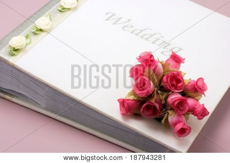 Close Up of Wedding Photo Album with Roses