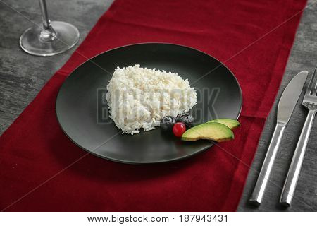 Plate with delicious tasty coconut rice on table