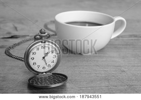 Pocket watch with coffee latte art relax time