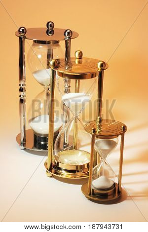 Row of Hourglasses on a Warm Background