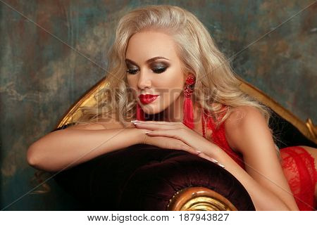 Beauty Makeup. Beautiful Fashion Blond Girl Model With Red Lips, Fashion Earrings, Blonde Wavy Hair