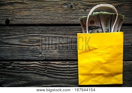 Dollars stick out of the shopping bag, shopping. American money, holidays