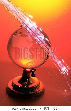 Globe with Optical Fibres on Red Background
