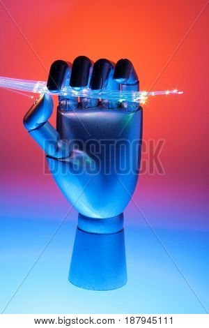 Hand with Optical Fibres on Red and Blue Background