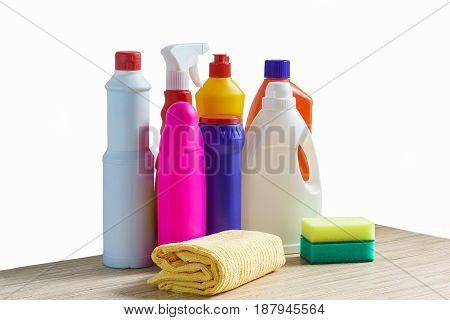 Colourful bottles of cleaning products sponge and rag for cleaning the home on white background