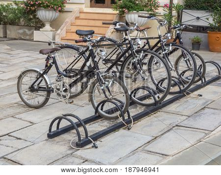 The bicycle parking in public.Bicycles are an economical journey and reduce global warming.