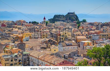 Panoramic view on classical Greek old houses buildings architecture of Greece Corfu island capital Kerkyra. Greece holidays vacation touristic tours. Old Venetian Fortress sightseeing view point.