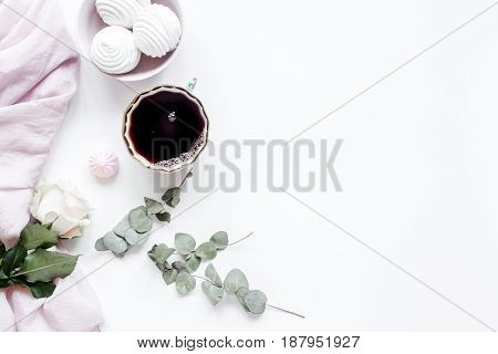 sweet lunch with marsh-mallow and spring flowers for woman on white table background top view mockup