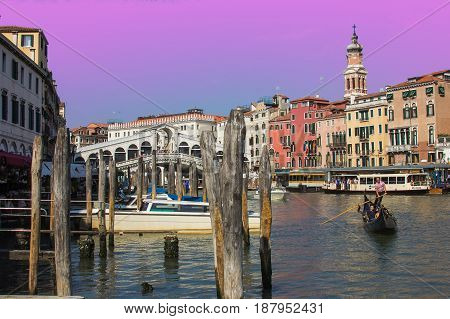 VENICE, ITALY - MAY 23, 2017: The famous Rialto bridge at the sunset. Venice is one of the best and romantic city of Europe