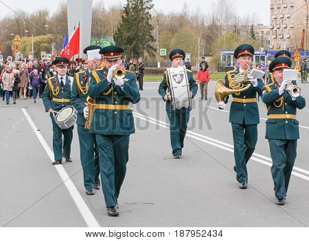 Kirishi, Russia - 9 May, Military musicians in front of the column, 9 May, 2017. Preparation and conduct of the action Immortal regiment in small cities of Russia.