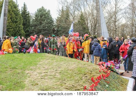 Kirishi, Russia - 9 May, People at the monument to the fallen soldiers, 9 May, 2017. Laying wreaths and flowers in memory of the fallen at the Eternal Flame.