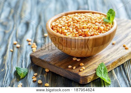 Dry Yellow Peas In A Wooden Bowl.