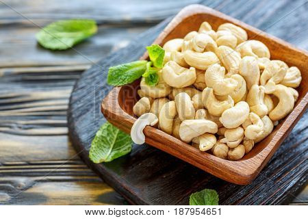 Wooden Bowl Of Cashew Nuts Close-up.