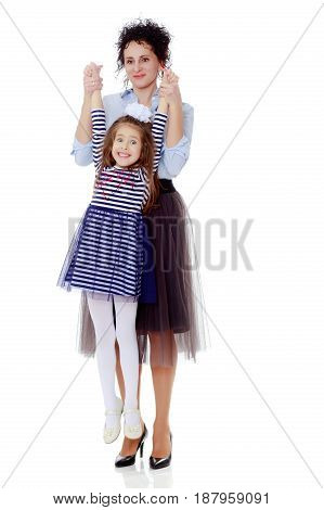 Happy young beautiful mother, lifted his little beloved daughter .Isolated on white background.