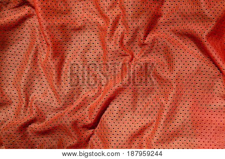 Sport Clothing Fabric Texture Background. Top View Of Red Polyester Nylon Cloth Textile Surface. Col