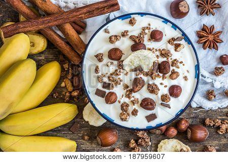Serving of White Yogurt with Muesli Banana and Nuts