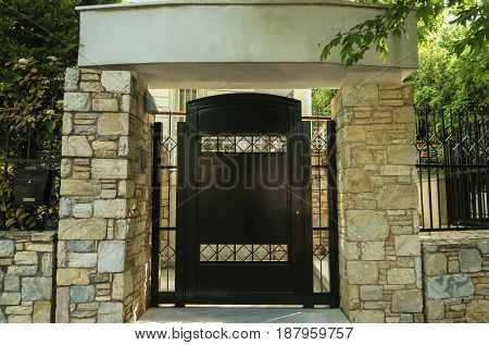 front door to the big house and the columns of stone