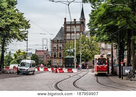 The Hague The Netherlands - August 7 2016: Street view in the Hague with tram tracks a cloudy day of summer.