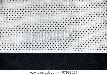 White Sport Clothing Fabric Texture Background. Top View Of White Cloth Textile Surface. Bright Bask