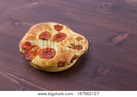 Pizza Bread With Tomatoes Isolated On An Ipe Natural Wood Table